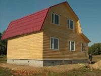 Дом с ломаной мансардной крышей