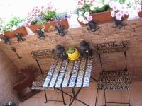 Уютный летний балкон