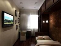 Стенка с навесными шкафами и встроенной кроватью в узкой спальне
