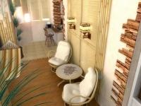 Дизайн лоджии с креслами и гамаком